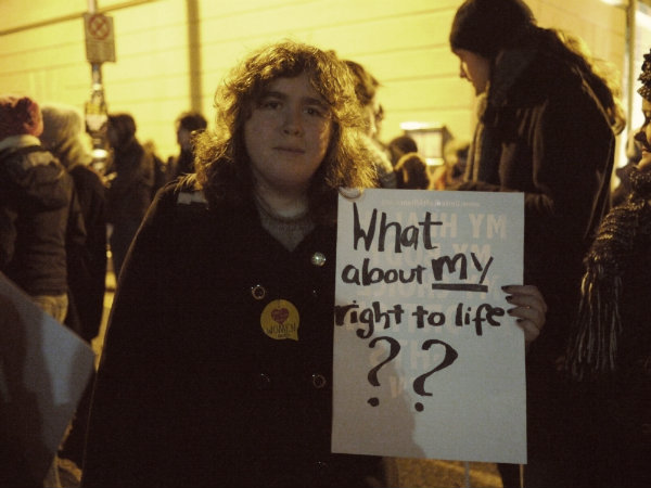 "Woman holds a sign saying ""What about MY right to choose?"""