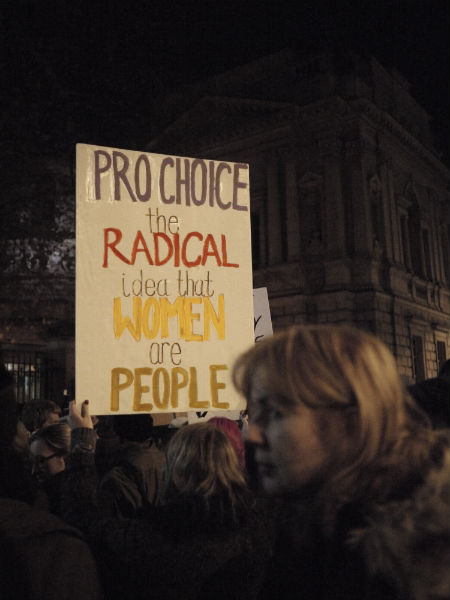 "Sign saying ""Pro choice: the radical notion that women are people"""