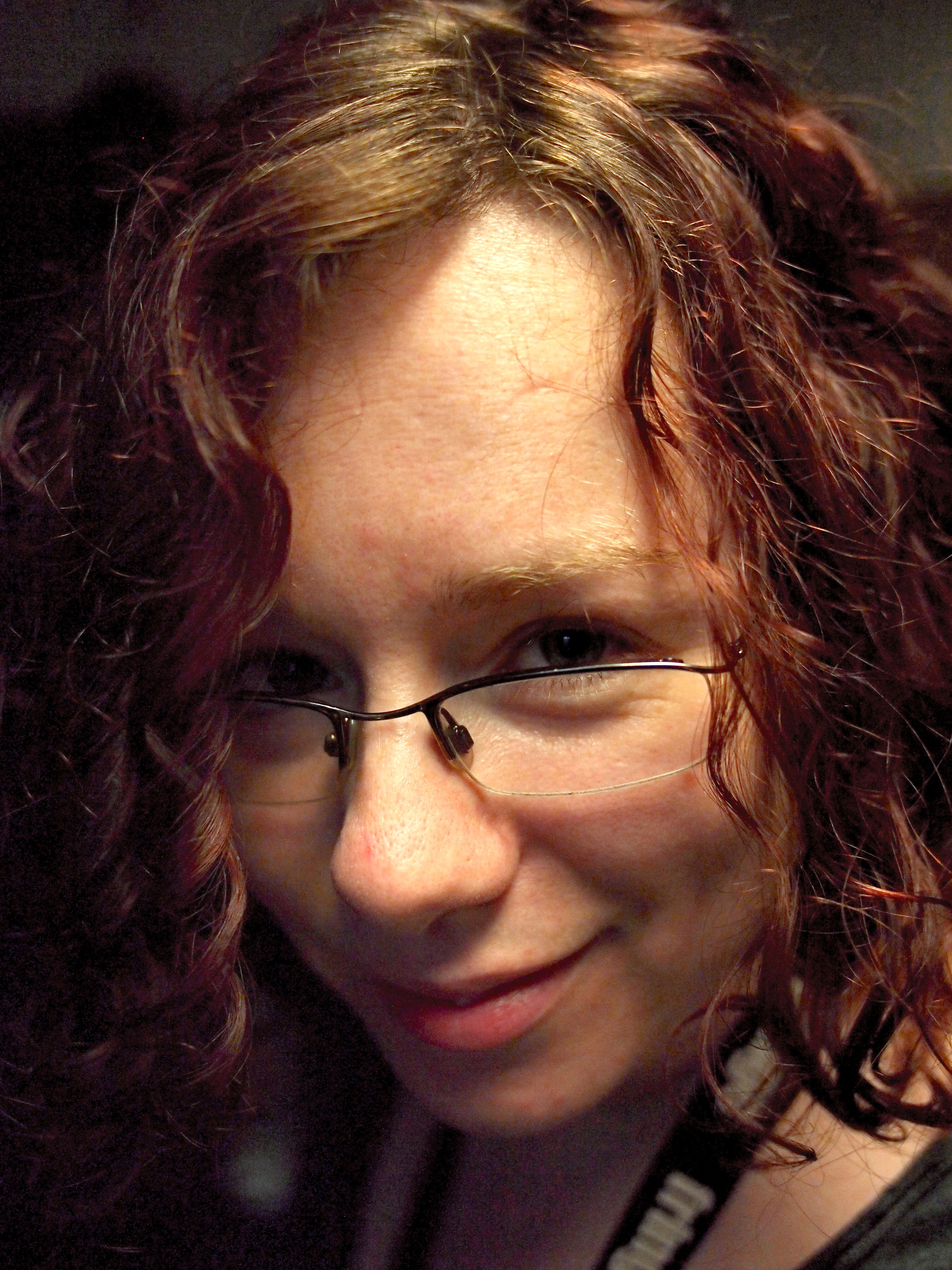 A close-up picture of me at 29: chin-length curly hair, looking at the camera.